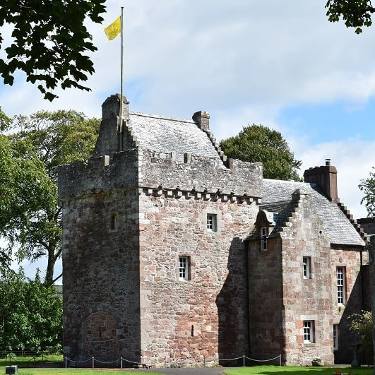 Book a visit to Hunterston Castle - exterior of the castle image with flag